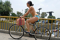In the middle of traffic a couple strip down naked and join the ride. Mexico City, on Saturday, June 9, 2007. An estimated 100 people participated in this protest designed to force cardrivers to be more concietious of vulnerable bike riders.