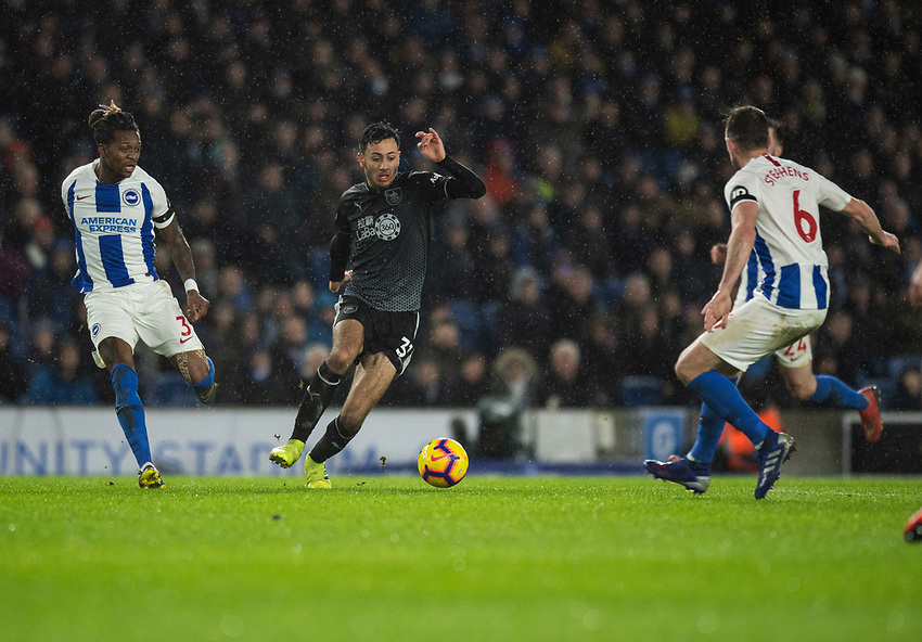 Burnley's Dwight McNeil (centre) under pressure from  Brighton & Hove Albion's Gaetan Bong (left) & Dale Stephens (right) <br /> <br /> Photographer David Horton/CameraSport<br /> <br /> The Premier League - Brighton and Hove Albion v Burnley - Saturday 9th February 2019 - The Amex Stadium - Brighton<br /> <br /> World Copyright © 2019 CameraSport. All rights reserved. 43 Linden Ave. Countesthorpe. Leicester. England. LE8 5PG - Tel: +44 (0) 116 277 4147 - admin@camerasport.com - www.camerasport.com