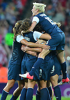 August 09, 2012: United States' Megan Rapinoe celebrates victory over Japan at the conclusion of Women's Football Final at the Wembley Stadium on day thirteen in Wembley, England. USA defeat Japan 2-1 to win it's third consecutive Olympic gold medal in women's soccer. ..
