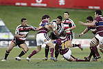 Niva Ta'auso tries to break through the Southland tacklers during the Air NZ Cup game between the Counties Manukau Steelers and Southland played at Mt Smart Stadium on 3rd September 2006. Counties Manukau won 29 - 8.