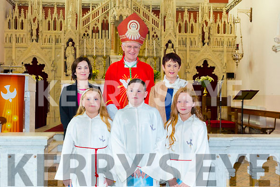 Douglas NS puipils Lily Sue Ayres, Ben O'Dwyer and Michelle Carr with their teacher Kay Divane and Dolores Johnston after they were confirmed by Bishop Ray Browne in St James Church, Killorglin on Tuesday