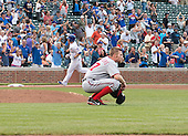Washington Nationals pitcher Steven Strasburg (37) crouches behind the pitchers mound and stares towards the outfield after giving up the game tying home run to Chicago Cubs third baseman Donnie Murphy (8), left background, in the ninth inning of the game at Wrigley Field in Chicago, Illinois on Thursday, August 22, 2013.  The Nationals won the game 5 - 4 in thirteen innings.<br /> Credit: Ron Sachs / CNP