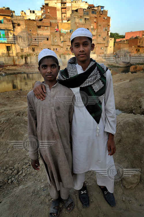 Two Muslim boys stand in a slum in the area of Nizamuddin East.