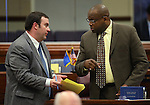Nevada Assembly Democrats James Ohrenschall, left, and William Horne work on the Assembly floor at the Legislative Building in Carson City, Nev., on Friday, May 24, 2013. <br /> Photo by Cathleen Allison