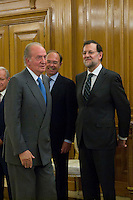30.07.2012. King Juan Carlos I of Spain attends the promise of the President of the Court of Auditors, Ramon Alvarez de Miranda Garcia, at the Royal Palace of La Zarzuela. In the image King Juan Carlos, Pio Garcia Escudero, Senate President and Mariano Rajoy Brey, President of governancy   (Alterphotos/Marta Gonzalez) *NortePhoto.com<br />