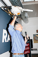 A man introduces Kentucky senator and Republican presidential candidate Rand Paul by lifting up a chainsaw at a town hall campaign event at Kilton Library in West Lebanon, New Hampshire. The chainsaw is a reference to a campaign video Rand Paul produced in which he destroys the US Tax Code with a chainsaw.