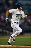 Left fielder Tim Tebow (15) of the Columbia Fireflies runs toward first in a game against the Lakewood BlueClaws on Friday, May 5, 2017, at Spirit Communications Park in Columbia, South Carolina. Lakewood won, 12-2. (Tom Priddy/Four Seam Images)