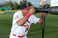 Springfield Cardinals first baseman Jonathan Rodriguez (28) takes photos of fans before a game against the Frisco Rough Riders on June 1, 2014 at Hammons Field in Springfield, Missouri.  Springfield defeated Frisco 3-2.  (Mike Janes/Four Seam Images)