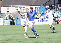 Terry Masson and Josh Todd challenge for the ball in the SPFL Ladbrokes Championship Play Off semi final match between Queen of the South and Montrose at Palmerston Park, Dumfries on  11.5.19.
