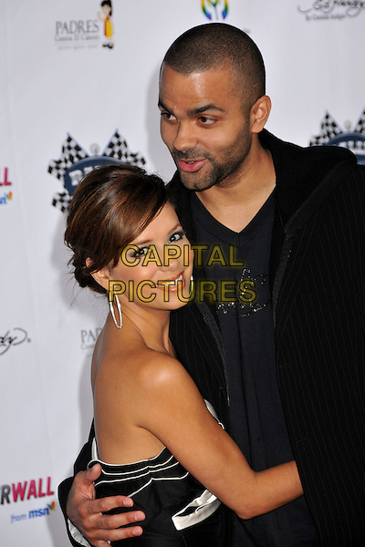 "TONY PARKER & EVA LONGORIA PARKER .Rally for Kids with Cancer ""The Qualifiers"" Celebrity Draft Party held at the Roosevelt Hotel, Hollywood, CA, USA, 1st May 2009..half length strapless black white folded married husband wife couple tall short  jacket hoodie hoop earrings beard facial hair stubble hugging cuddling .CAP/ADM/BP.©Byron Purvis/Admedia/Capital Pictures"