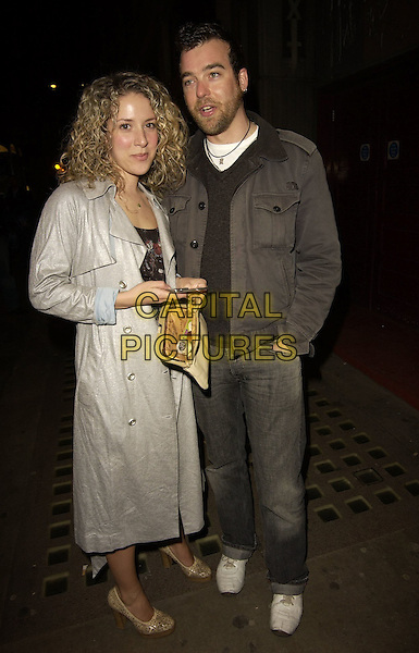 "NATALIE CASEY & GUEST.Outside arrivals for ""Movin' Out"" Opening Night, .Apollo Victoria Theatre, London, England, .April 10th 2006..full length grey silver coat mac.Ref: CAN.www.capitalpictures.com.sales@capitalpictures.com.©Can Nguyen/Capital Pictures"