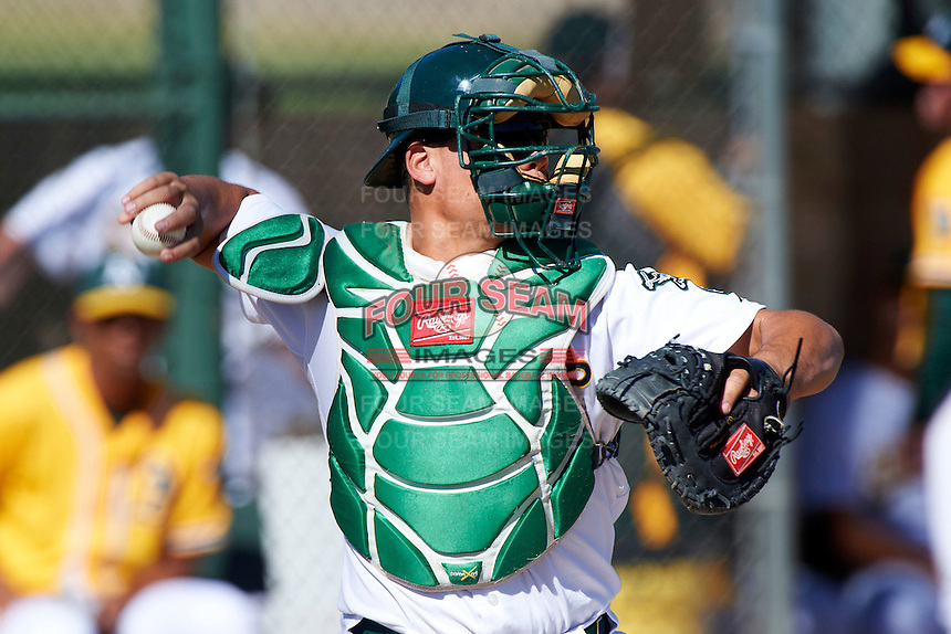 Oakland Athletics minor league catcher Bruce Maxwell #33 during an instructional league game against the San Francisco Giants at the Papago Park Baseball Complex on October 17, 2012 in Phoenix, Arizona. (Mike Janes/Four Seam Images)