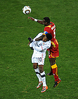 Robbie Findley of USA is overpowered in the air by John Mensah of Ghana. USA vs Ghana in the 2010 FIFA World Cup at Royal Bafokeng Stadium in Rustenburg, South Africa on June 26, 2010.