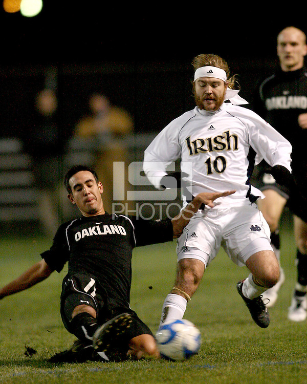 Gabriel Hernandez #11 of Oakland slides the ball away from Joseph Lapira #10 of Notre Dame. The University of Notre Dame defeated Oakland University 2-1 in the second round of the NCAA championship at Alumni Field at the University of Notre Dame in South Bend, Indiana on November 28, 2007.