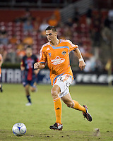 Houston Dynamo midfielder Geoff Cameron (20) dribbles the ball.  Houston Dynamo defeated Atlante FC 4-0  during the group stage of the Superliga 2008 tournament at Robertson Stadium in Houston, TX on July 12, 2008.