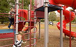 WOODBURY, CT-101417JS11-- Ayden Arigo and his brother Bradley, spend Saturday afternoon at Hollow Park in Woodbury with their grandmother Pat Coelho. Woodbury selectmen will discuss the Hollow Park Playscape at an upcoming meeting. They should be able to order parts for the new playscape before the end of the year. Jim Shannon Republican-American
