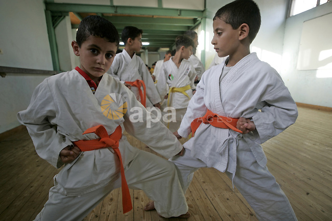 A Palestinian children take part at karate training in Rafah the southern Gaza Strip on July 2, 2009. Photo By Abed Rahim Khatib