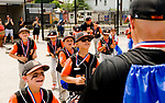 WATERBURY, CT-0712117JS15--Water-Oak players run up to accept their trophy after defeating the Bonnie's of Brooklyn 12-3 in their consolation bracket game in the Roberto Clemente Tournament Thursday at the Waterbury PAL field. <br /> Jim Shannon Republican-American