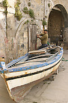 Fisherman with boat out of water. Sicily