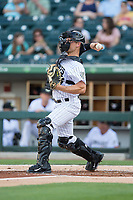 Charlotte Knights catcher Carson Blair (5) makes a throw to third base against the Durham Bulls at BB&T BallPark on May 16, 2017 in Charlotte, North Carolina.  The Knights defeated the Bulls 5-3. (Brian Westerholt/Four Seam Images)