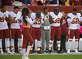 Washington Redskins linebacker Preston Smith (94), linebacker Ryan Kerrigan (91), linebacker Zach Brown (53), linebacker Pernell McPhee (96) and linebacker Ryan Anderson (52) stand as the National Anthem is sung prior to the game against the Dallas Cowboys at FedEx Field in Landover, Maryland on Sunday, October 21, 2018.<br /> Credit: Ron Sachs / CNP