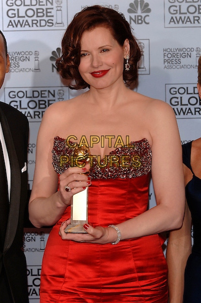 "GEENA DAVIS.HFPA 63rd Golden Globe Awards at The Beverly Hills Hilton, Beverly Hills, California, USA..Awarded ""Best Actress Drama Series"".January 16th, 2006.Ref: PL.globes half length red strapless dress award trophy nail polish varnish lipstick .www.capitalpictures.com.sales@capitalpictures.com.©Phil Loftus/Capital Pictures"