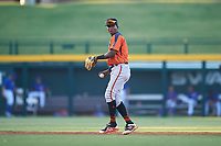 AZL Giants Orange shortstop Marco Luciano (10) throws to first base during an Arizona League game against the AZL Cubs 1 on July 10, 2019 at Sloan Park in Mesa, Arizona. The AZL Giants Orange defeated the AZL Cubs 1 13-8. (Zachary Lucy/Four Seam Images)