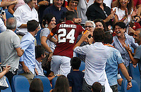 Calcio, Serie A: Roma vs Cagliari. Roma, stadio Olimpico, 21 settembre 2014.<br /> Roma midfielder Alessandro Florenzi runs to hug his grandmother Aurora on the stand after scoring during the Italian Serie A football match between AS Roma and Cagliari at Rome's Olympic stadium, 21 September 2014.<br /> UPDATE IMAGES PRESS/Riccardo De Luca