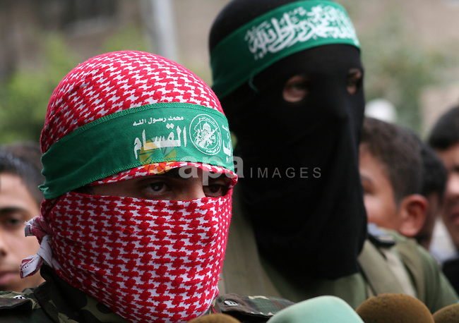 "Members of the Military Wing of Hamas  ""Izz Deen Qassam"" hold a press conference, in Gaza City. Three Israeli soldiers and four militants have been killed as troops backed by assault helicopters stormed into the Gaza Strip."
