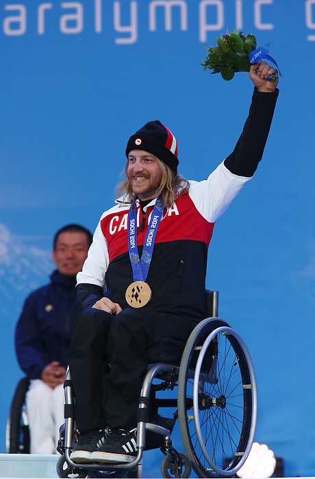 Sochi, Russia, 09/03/2014. Canadian  sit skier Caleb Brosseau celebrates his Bronze medal win in the men's Super G sitting event at the Sochi 2014 Paralympic Winter Games in Sochi Russia. (Photo Scott Grant/Canadian Paralympic Committee)