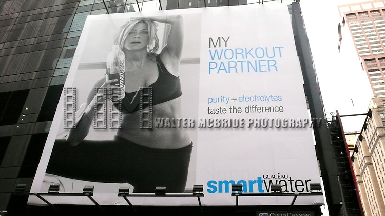 Promotional Billboard of Actress Jennifer Aniston shows off her taut, lean abs in a sexy new ad for SmartWater vitamin water..The copy reads: Working out feels great...afterwards. That's why I drink Smart. It's hydration I can feel. (And it's one part of my routine I never sweat.)  HER NOSE?  While most magazine ads are photoshopped, Aniston's nose in the latest SmartWater ad looks different from her own: the bridge looks thinner and the nostrils look like a snout rounder than usual..[Editor's note: Jen's real nose is more attractive than the photoshopped version, so what gives??].Aniston, who has been a SmartWater rep since 2007, has already had two nose jobs: One in 1995 when she started out in her career, and another in 2007.Times Square, New York City.  August 7, 2010.© Alice Erardy / Starlitepics