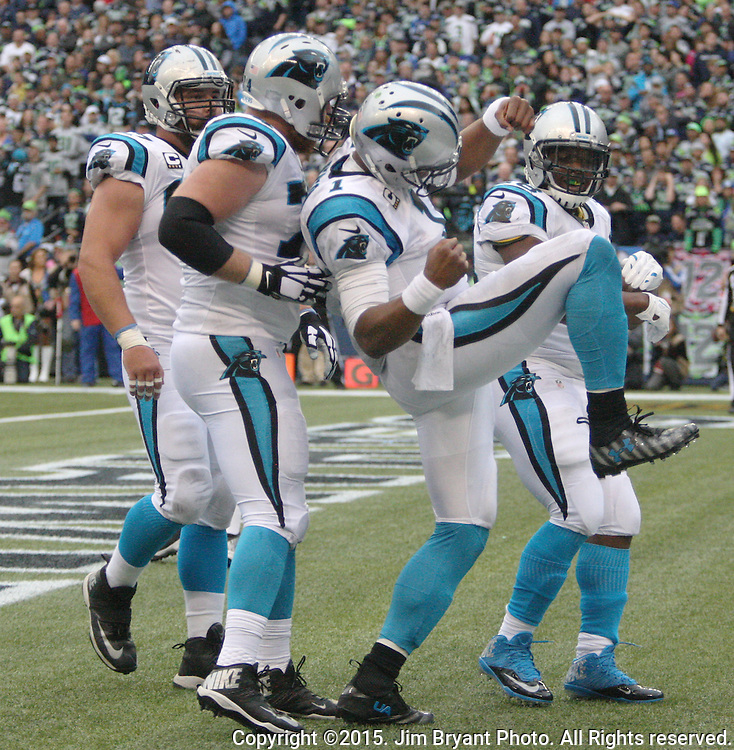 Carolina Panthers quarterback Kam Newton (1) celebrates his 2-yard touchdown run against the Seattle Sehawks at CenturyLink Field in Seattle on October 18, 2015. The Panthers came from behind with 32 seconds remaining in the 4th Quarter to beat the Seahawks 27-23.  ©2015 Jim Bryant Photography. All Rights Reserved.
