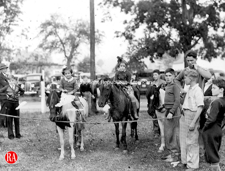 DURHAM - Two young ladies wait their turn to ride their horses in this undated photograph of the Durham Fair.