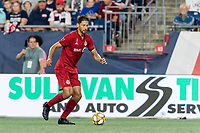 FOXBOROUGH, MA - AUGUST 31: Omar Gonzalez #44 of Toronto FC dribbles at midfield during a game between Toronto FC and New England Revolution at Gillette Stadium on August 31, 2019 in Foxborough, Massachusetts.
