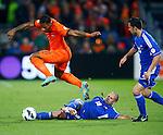 Nederland, Rotterdam, 12 oktober 2012.Kwalificatiewedstrijd WK 2014.Nederland-Andorra .Jeremain Lens (l.) van Oranje en Josep Ayala (m.) van Andorra strijden om de bal. Rechts Adrian Rodrigues van Andorra.