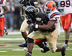 2 September 2006: Wake Forest's Micah Andrews (left) is brought down from behind by Syracuse's Jerry Mackey (57). Wake Forest defeated Syracuse 20-10 at Groves Stadium in Winston-Salem, North Carolina in an NCAA college football game.