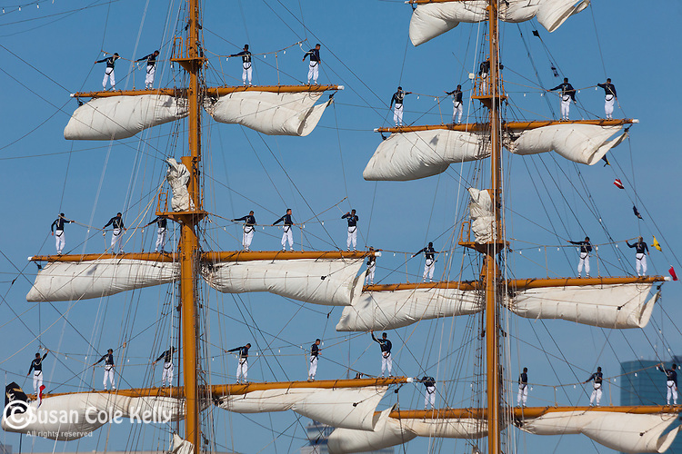 Sailors On the Yard Arms of the tall ship Guayas from Equador in Boston Harbor, Boston, Massachusetts, USA