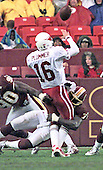 Arizona Cardinals quarterback Jake Plummer (16) is hit after releasing the ball in first quarter action against the Washington Redskins at FedEx Field in Landover, Maryland on January 6, 2002. The Redskins won the game 20 - 17.<br /> Credit: Arnie Sachs / CNP
