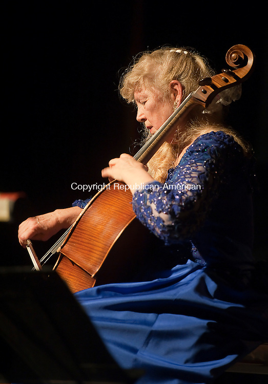 THOMASTON,  CT-122114JS04- Concert cellist Thirzah Bendokas plays a classical piece during a special &quot;Cello-bration&quot; holiday concert Sunday at the Thomaston Opera House. <br />  Jim Shannon Republican-American