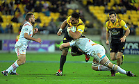 Sam Cane tackles Victor Vito during the Super Rugby semifinal match between the Hurricanes and Chiefs at Westpac Stadium, Wellington, New Zealand on Saturday, 30 July 2016. Photo: Dave Lintott / lintottphoto.co.nz
