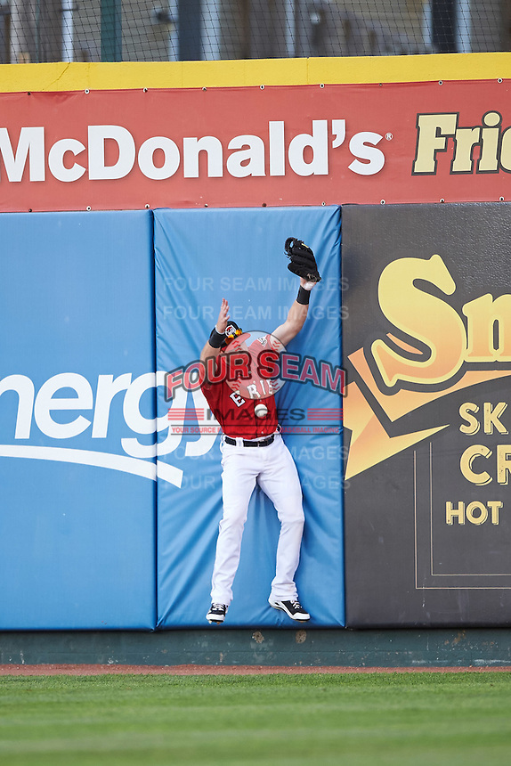 Erie SeaWolves right fielder Mike Gerber (32) crashes into the wall attempting to catch a fly ball during a game against the Richmond Flying Squirrels on August 22, 2016 at Jerry Uht Park in Erie, Pennsylvania.  Erie defeated Richmond 4-2.  (Mike Janes/Four Seam Images)