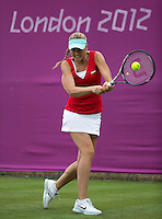 Agnes Szavay - Hungary..Tennis - OLympic Games -Olympic Tennis -  London 2012 -  Wimbledon - AELTC - The All England Club - London - Saturday 28th June  2012. .© AMN Images, 30, Cleveland Street, London, W1T 4JD.Tel - +44 20 7907 6387.mfrey@advantagemedianet.com.www.amnimages.photoshelter.com.www.advantagemedianet.com.www.tennishead.net