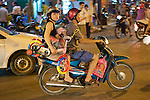 Family On Motorbike Holding Bicycle