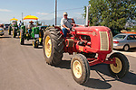 Ron Smith drives Dick Weaton's 1953 Cockshutt 50 in the tractor parade at the annual EDGE & TA chapter 132 tractor show and pull in Bill Ramsus in the Carson Valley