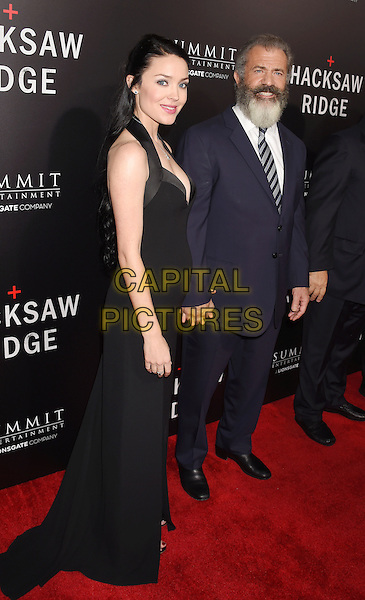 BEVERLY HILLS, CA - OCTOBER 24: Director Mel Gibson (R) and Rosalind Ross attend the screening of Summit Entertainment's 'Hacksaw Ridge' at Samuel Goldwyn Theater on October 24, 2016 in Beverly Hills, California.<br /> CAP/ROT/TM<br /> &copy;TM/ROT/Capital Pictures