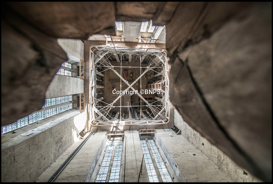 BNPS.co.uk (01202 558833)<br /> Pic: TomWren/BNPS<br /> <br /> In-spire-ing View..<br /> <br /> A newly revealed gap in the floor of Salisbury Cathedral's spire has uncovered a vertigo inducing view down on to the ceiling of the famous old church's crossing 120 ft below.<br /> <br /> Taken through a hole in the wooden floor, the photos show the view 120ft down the square tower, from just below the base of the famous spire to the roof of the rest of the cathedral.<br /> <br /> The hole is used in conjunction with a trapdoor to allow staff to carry material into the building's famous spire - the tallest in England at 404ft from ground level - without having to climb the 332 steps of narrow winding spiral staircases.<br /> <br /> At the popular landmark in Salisbury, Wilts, people can pay to go on a Tower Tour, which takes them 225ft above ground level to the base of the spire. <br /> <br /> From there they can see up into the spire to look at its original medieval scaffolding, but these pictures show the view down - something even the paying tourists do not normally see.