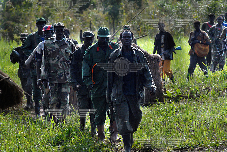 Lord's Resistance Army (LRA) leader Joseph Kony (fourth from front) and his soldiers arrive at peace talks near the Congolese border. For the last two decades Joseph Kony and the Lord's Resistance Army have been terrorising the northern provinces of Uganda, abducting over 20,000 children and forcing 1.6 million people to flee their homes.
