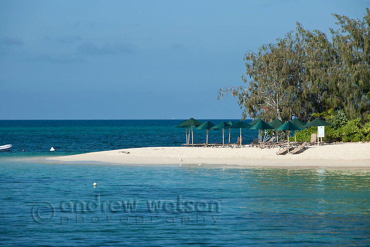 Beach chairs and umbrellas on Green Island - a coral cay off the coast of Cairns.  Great Barrier Reef Marine Park, Queensland, Australia