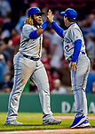 22 June 2019: Toronto Blue Jays third baseman Vladimir Guerrero Jr. gets a high-five from Manager Charlie Montoyo after a win against the Boston Red Sox at Fenway :Park in Boston, MA. The Blue Jays rallied to defeat the Red Sox 8-7 in the 2nd game of their 3-game series. Mandatory Credit: Ed Wolfstein Photo *** RAW (NEF) Image File Available ***