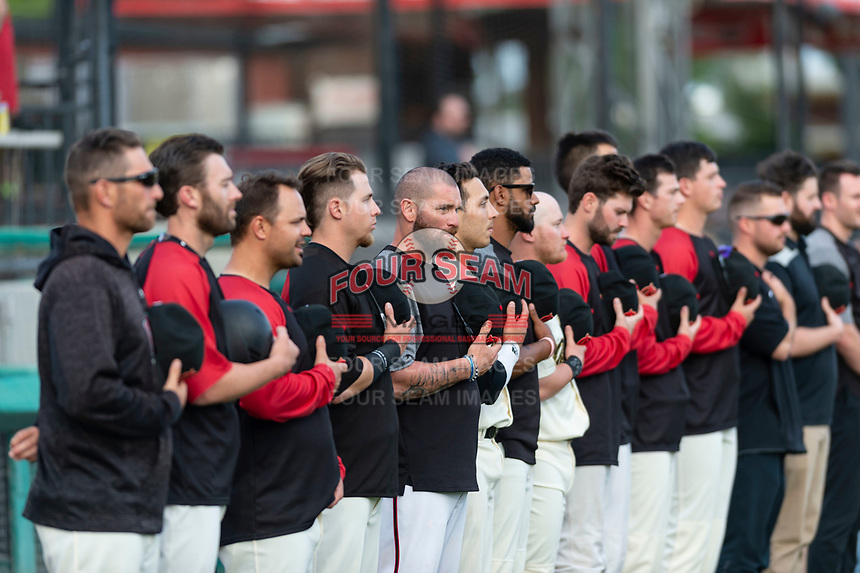 Visalia Rawhide coach Jonny Gomes during the National Anthem before a California League game against the Rancho Cucamonga Quakes on April 8, 2019 in Visalia, California. Rancho Cucamonga defeated Visalia 4-1. (Zachary Lucy/Four Seam Images)